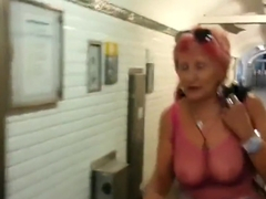 Sexy granny whith see thru top in public