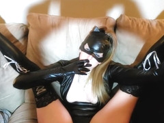 Mistress in a latex catwomen suit smoking fetish