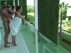 Public sex with a beautiful girl on the transparent balcony of the hotel