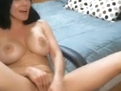Playful milf getting naked on webcam at home