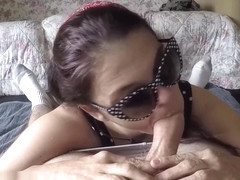 Angel Stone in polka dot dress and sunglasses blows cock for facial