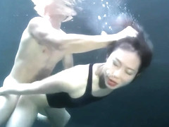 swimsuit girl sex with a guy underwater