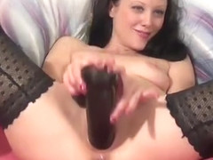 she fucks her pussy with a huge black toy3.wmv