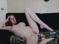 Busty redhead fucks herself in the ass
