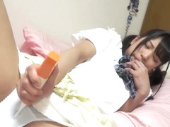 Japanese girl Mari masturbates through her panties