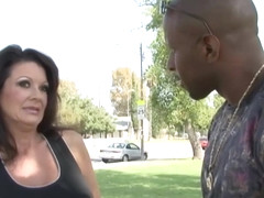 Mature, Latin woman, Raquel Divine likes to have steamy sex with a handsome, black guy