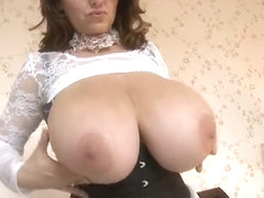 Stunning breasty mature female making a kinky fetish performance