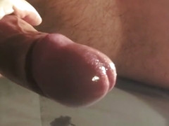 Fast slapping a tied cock