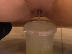 Blonde loves fetish outfit and masturbating after a golden shower, dildo in anal and wet pussy.