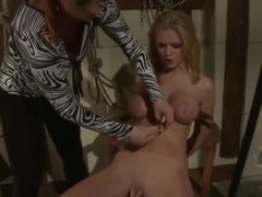 Bound lesbian gets clamps on pussy while sucking nipples