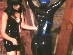 Girl In Latex With Inflatable Hood Spanked
