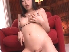 Dirty chick turns on with large dildo