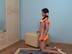 skinny teen gymnast stretching