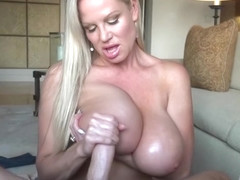 Kelly rubs her guys dick on her big tits