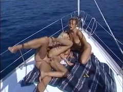 Threesome on sailing boat