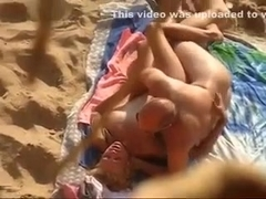 Hidden cam video with a mature amateur couple banging on a beach