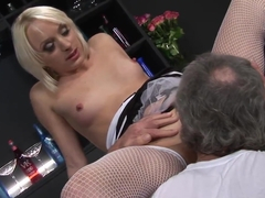 Blondie in stockings has a dick in her hole and another in her mouth