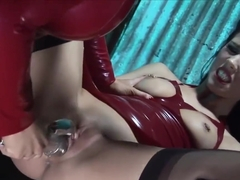 latex catsuit fucks slaves pussy in gyno chair