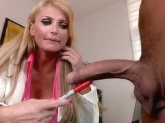 Taylor Wane with her unnaturally big boobs enjoying a big cock
