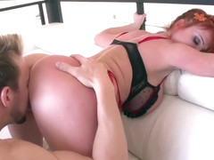 Busty redhead in sexy underwear, Taylor Wayne is fucking her partner, while on the sofa
