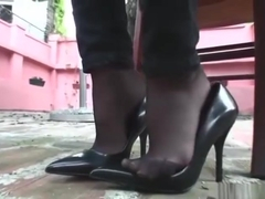 Shoeplay, dangling and sexy feet in black pantyhose and jeans