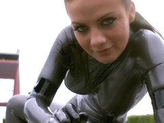 Model in latex catsuit