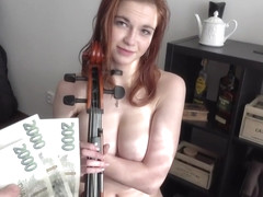 Busty, red haired honey is giving a titjob to a guy she liked a lot