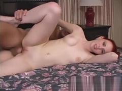 Candi Summers has bright fake red hair with a big