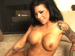 Mason records some home video footage of herself masturbating in front of a fireplace