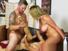 Busty massage babe gets cum in mouth in trio