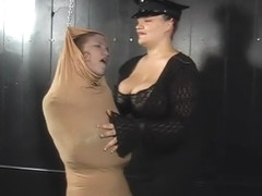 Madison straitjacked , encased in Nylons and Saran