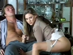 Victoria Swinger teases him with her stockings and jacks him off