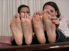 Girls feet ache, four bare sore feet are tended to with toe spreading rubs