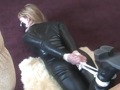 Blonde in latex and boots (Beauties in Bondage)