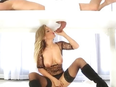Busty blonde plays with toy and gives a handjob