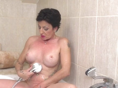 Horny Housewife Playing With Her Shaved Pussy In The Bathtub - MatureNL