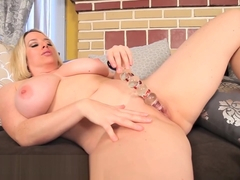 Busty Blonde Maggie Green Gets Off with Glass Dildo!