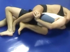 Mixed wrestling - strong woman scissors
