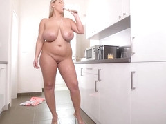 Big titted blonde, Krystal Swift likes to rub her pussy in the kitchen, until she cums