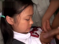 Japanese big tits schoolgirl with pigtails takes a cock inside her mouth