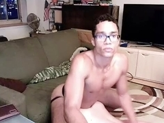 Nice male is jerking off in the bedroom and filming himself on camera
