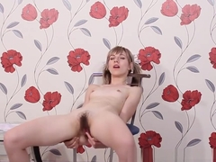 Yuliya sucks a lollipop and then masturbates naked