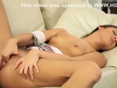 Hot brunette young beauty uses dildo to masturbate