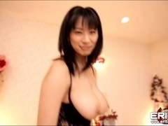 Hana Haruna lubes cock and let it slides between her large juggies