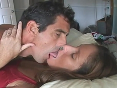 a1cfb40311 Couple erotic deep sensuous tongue kissing in bed.