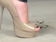 Diana crushing roaches in sharp sexy high heels.