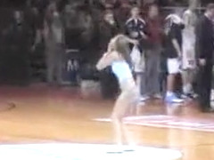 Topless girl streaks at a basketball game