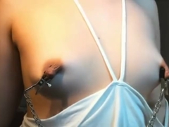 Puffy nipples in clamp and teased on girl in glasses