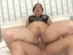 Nice buxomy mature woman Melissa Monet is giving head
