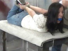 white masked woman hogtied